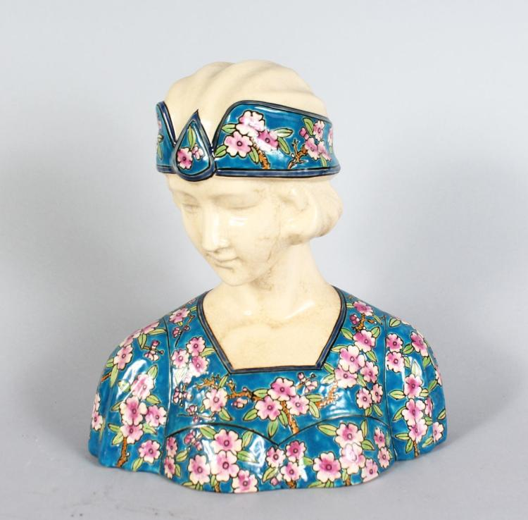 AN ART DECO STYLE POTTERY BUST. 10ins high.