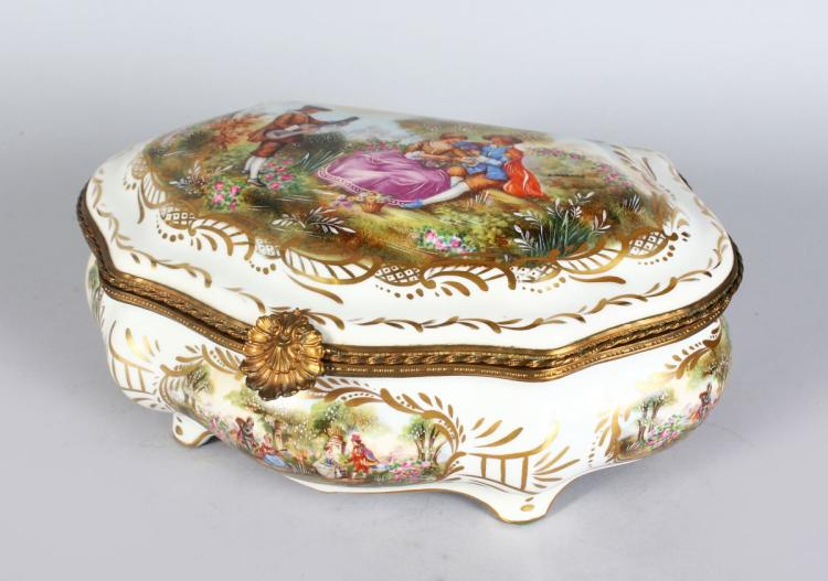 A SEVRES STYLE PORCELAIN CASKET, with ormolu mounts, decorated with a courting couple. 1ft 2ins wide.