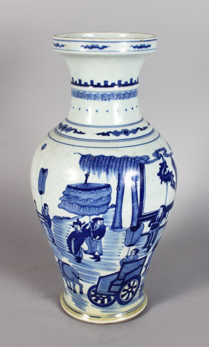 A CHINESE BLUE AND WHITE VASE, decorated with figures and animals. 1ft 4ins high.