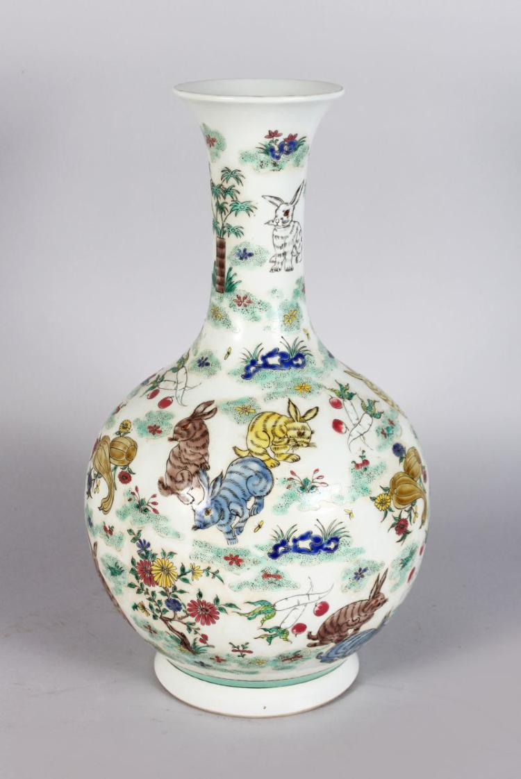 A CHINESE BULBOUS SHAPED VASE, decorated with rabbits in a landscape. 1ft 4ins high.