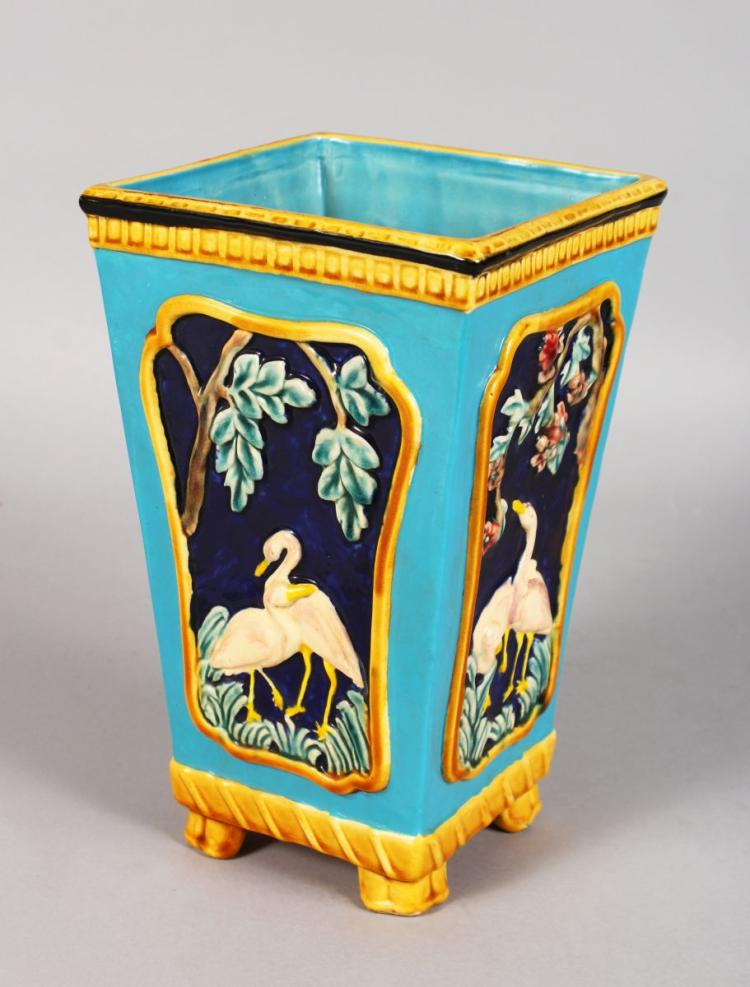 A MAJOLICA TYPE SQUARE TAPERING VASE decorated with geese. 9.5ins high.