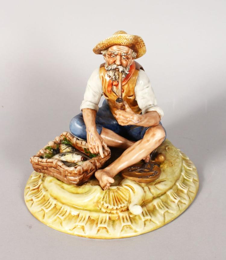 A CAPODIMONTE PORCELAIN GROUP, old man smoking a pipe, basket of fish by his side. 7ins high.