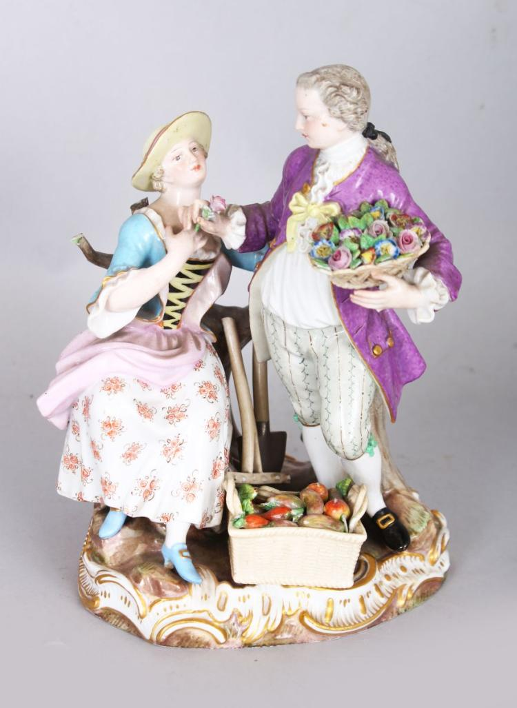 A GOOD 19TH CENTURY MEISSEN GROUP OF A GALLANT carrying a basket of flowers, a young lady seated by his side, with spade and vegetables in a basket, Cross swords mark in blue. 6.5ins high.