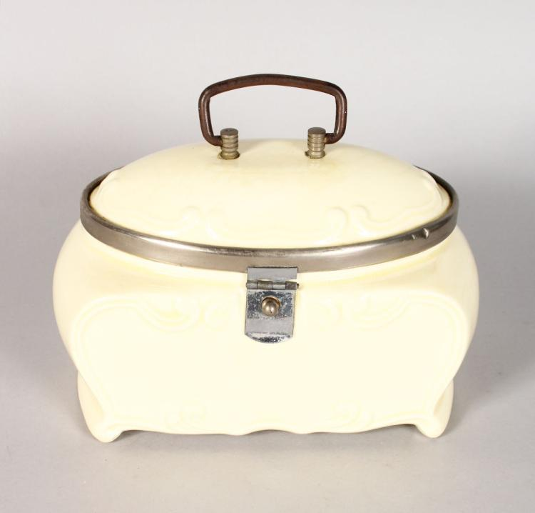 AN ART DECO DESIGN PORCELAIN SANDWICH BOX, cream. 7ins long.