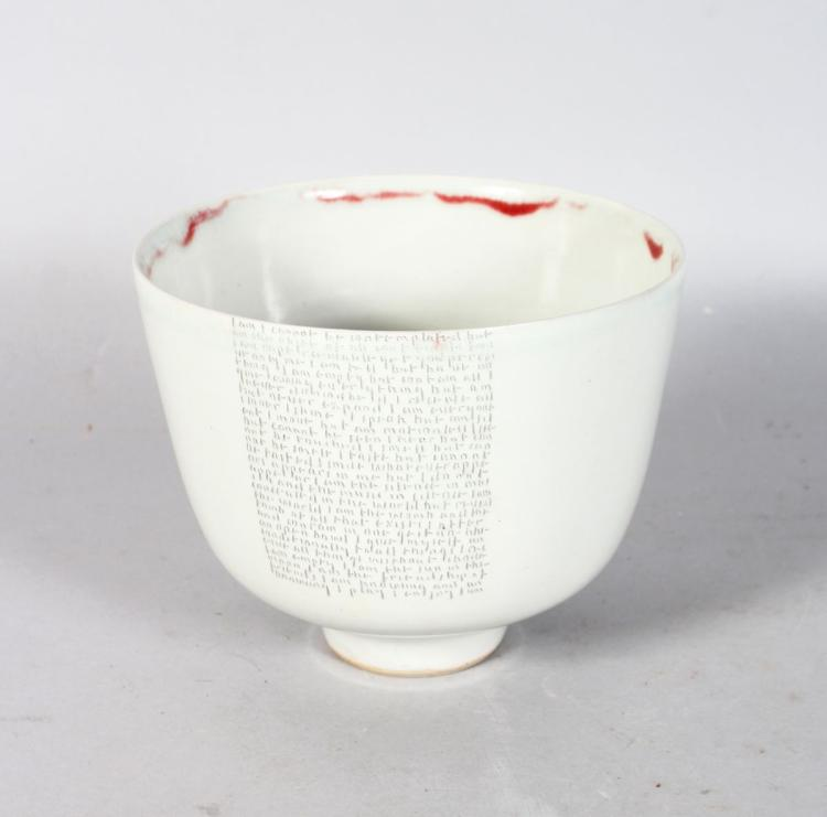 AN UNUSUAL CIRCULAR BOWL by RUPERT SPIRA, with pale grey glaze, red free-form glazed rim, the body with incised poem, on a small footed base, raised RS mark. 5.5ins high.