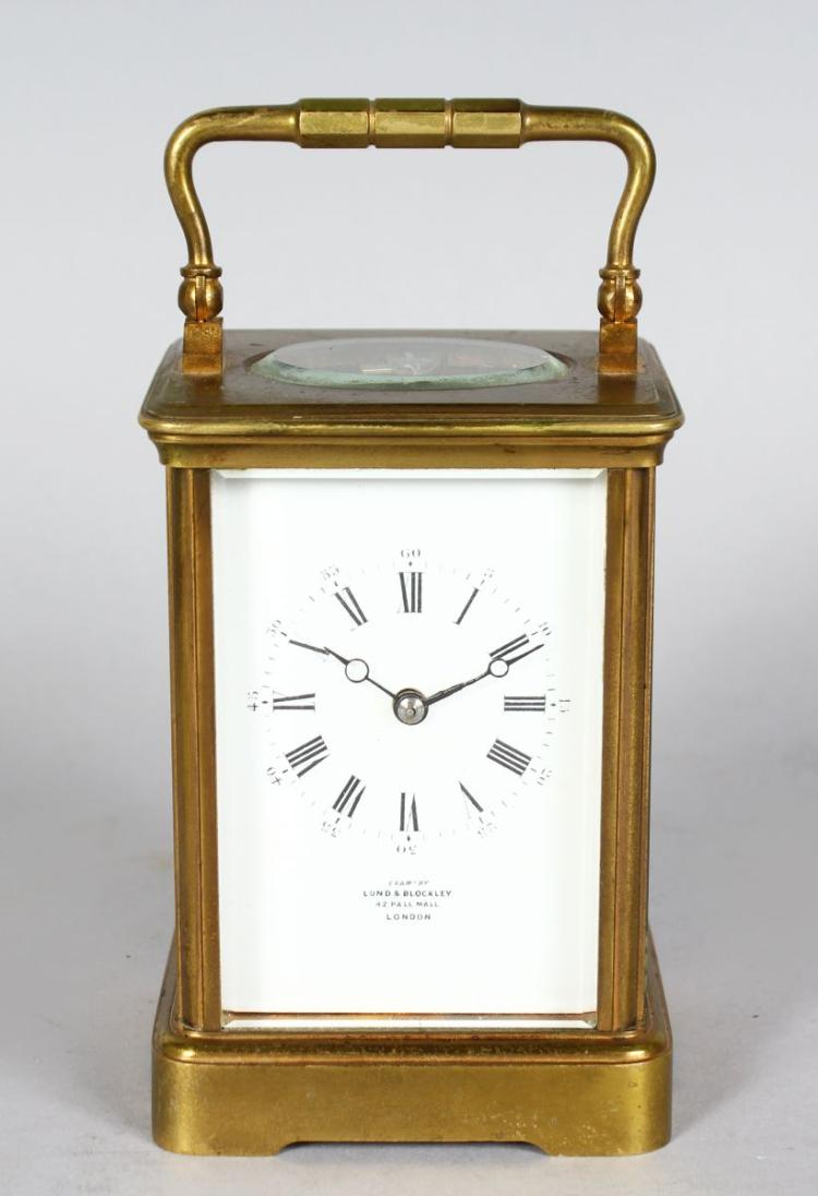 A 19TH CENTURY FRENCH BRASS CARRIAGE CLOCK striking on a gong, Retailed by LUND & BLOCKLEY, 42 PALL MALL, LONDON.