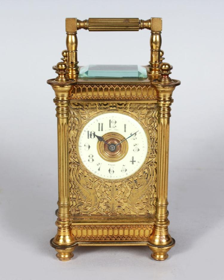 A 19TH CENTURY FRENCH BRASS CARRIAGE CLOCK with cream porcelain dial and filigree front, R. & C., PARIS.