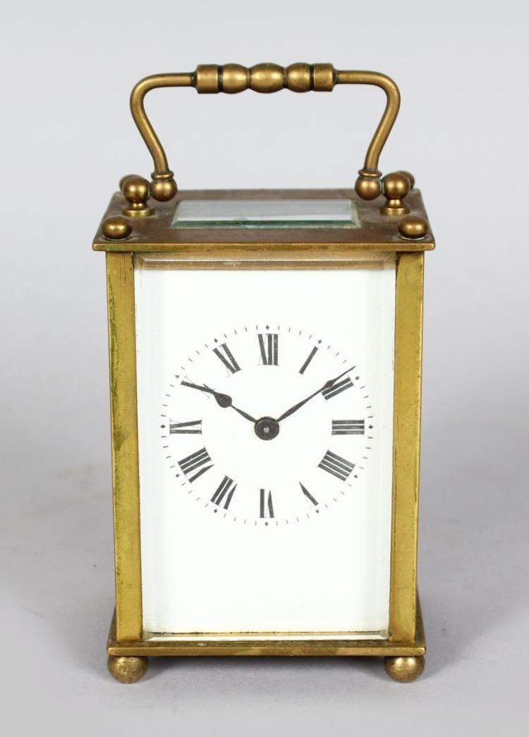A 19TH CENTURY FRENCH BRASS CARRIAGE CLOCK. 4ins high.