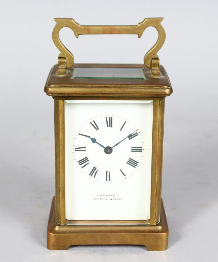 A 19TH CENTURY FRENCH BRASS CARRIAGE CLOCK, Retailed by J. A. HASKELL, IPSWICH & PARIS. 4.5ins high.
