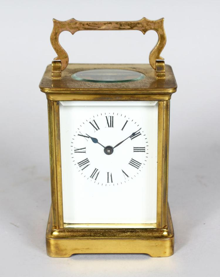A 19TH CENTURY FRENCH BRASS CARRIAGE CLOCK. 4.5ins high.