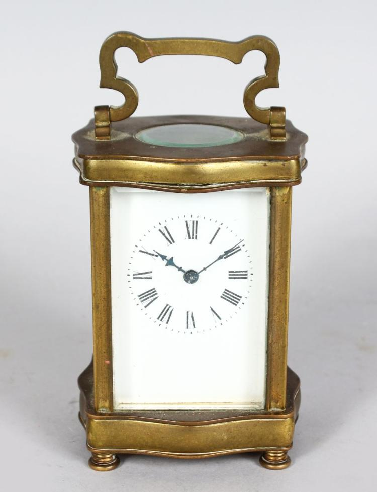 A 19TH CENTURY FRENCH BRASS SERPENTINE FRONTED CARRIAGE CLOCK. 5ins high.