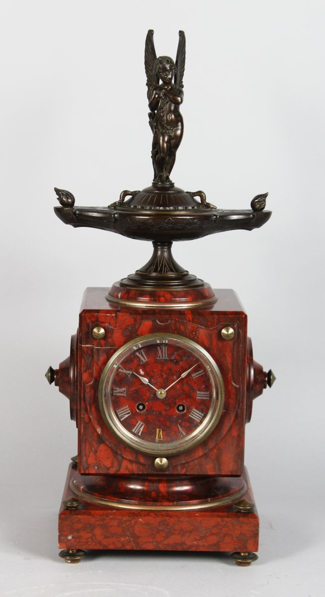 A VERY GOOD 19TH CENTURY FRENCH ROUGE MARBLE SQUARE MANTLE CLOCK with eight-day movement by CHARPENTIER FT. DE BRONZES, PARIS, No. 675, surmounted by a double-ended lamp with a winged cupid. 19ins high.