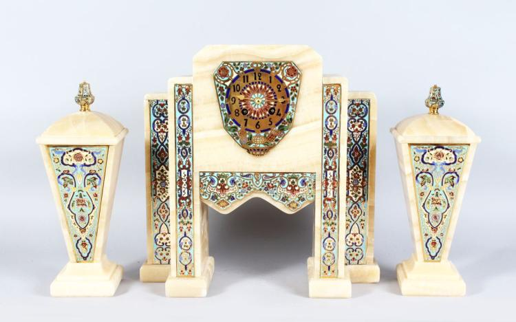 A SUPERB ART DECO CHAMPLEVE ENAMEL AND MARBLE THREE PIECE CLOCK SET CIRCA 1920, the case of Turkish design with Champleve panels with an eight day movement, 14ins high, complete with a pair of side pieces of tapering form, 12ins high.
