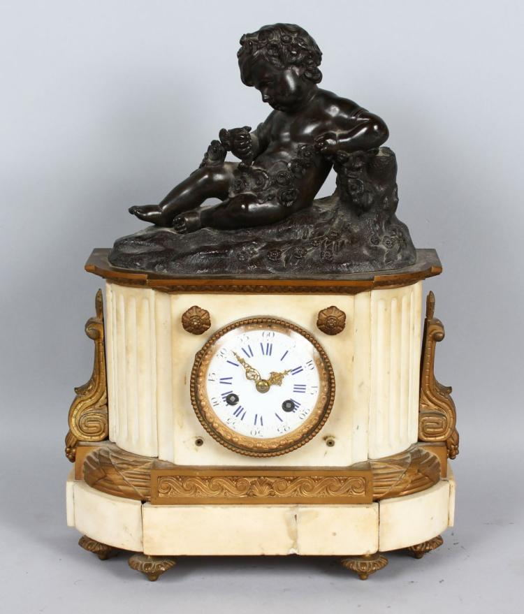 A 19TH CENTURY FRENCH WHITE MARBLE, BRONZE AND ORMOLU CLOCK , with circular dial, blue and white Roman numerals, eight-day movement, striking on a bell, surmounted by a bronze cupid holding a garland of flowers. 15ins high.