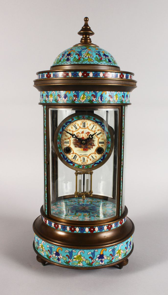 AN UNUSUAL, LARGE CHAMPLEVE ENAMEL FOUR GLASS CLOCK, of pagoda form, with decoratively painted dial, on turned feet. 1ft 10ins high.