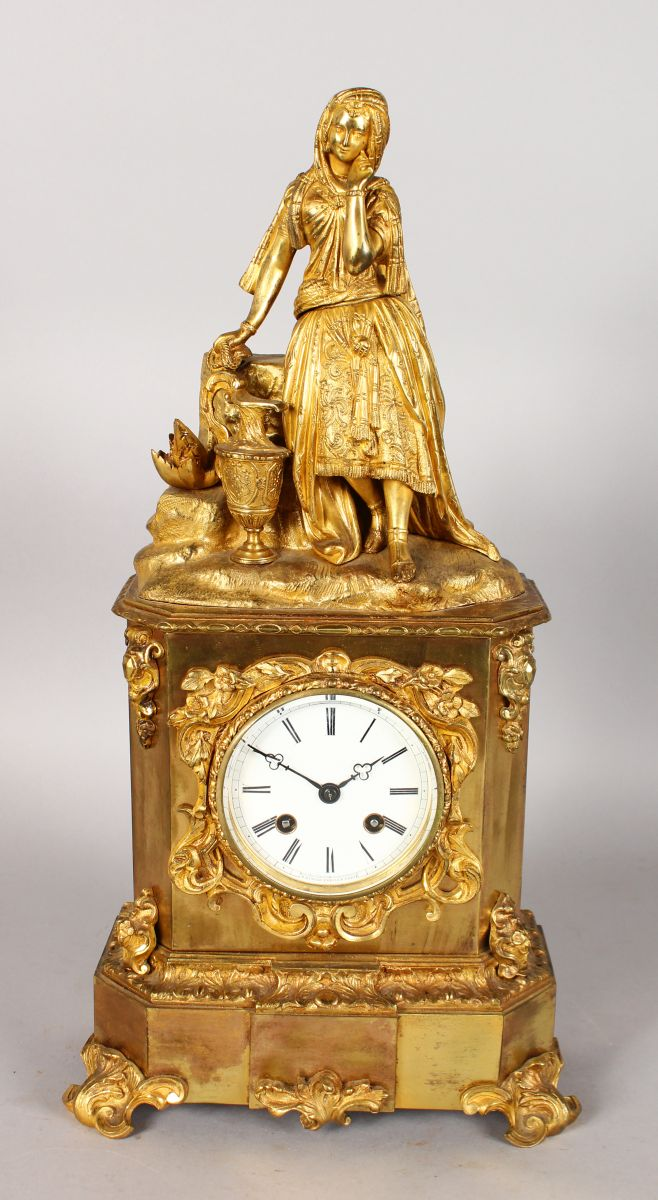 A GOOD 19TH CENTURY FRENCH ORMOLU CLOCK by RAINGO FRERES, PARIS, with eight-day movement, the case surmounted by a young lady at a well. 17ins high.