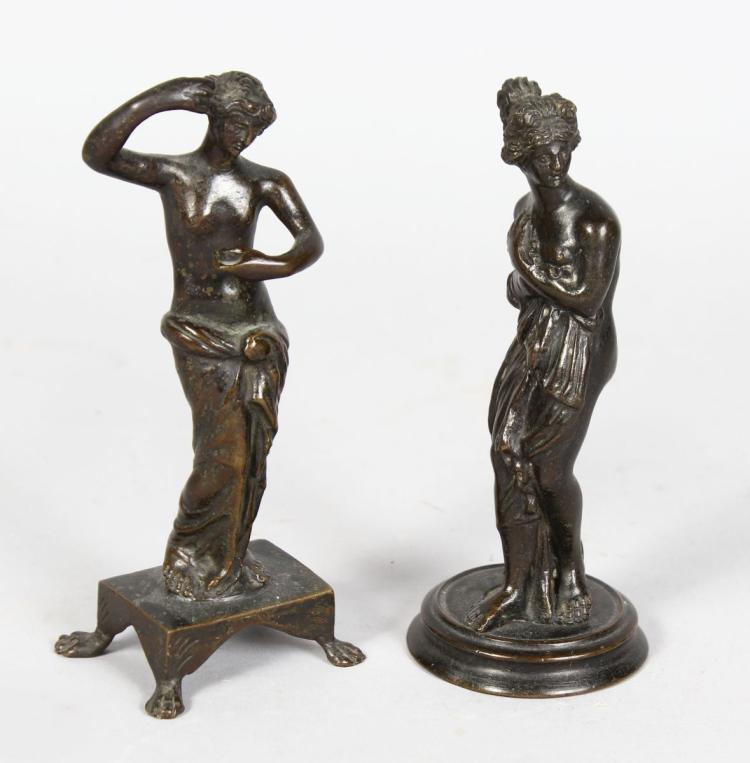 AFTER THE ANTIQUE A SMALL PAIR OF BRONZE FIGURES OF VENUS. Both 5ins high.