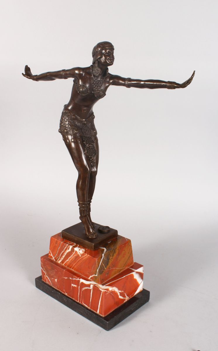AN ART DECO STYLE BRONZE FIGURE OF A DANCER, arms outstretched, on a stepped marble base. 1ft 7ins high.