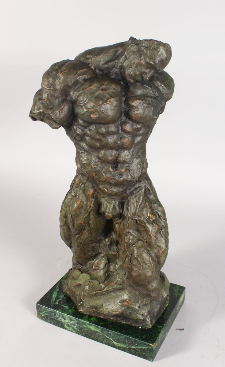 AN UNUSUAL ABSTRACT BRONZE, TORSO OF A MAN, on a rectangular marble base. 1ft 10ins high.