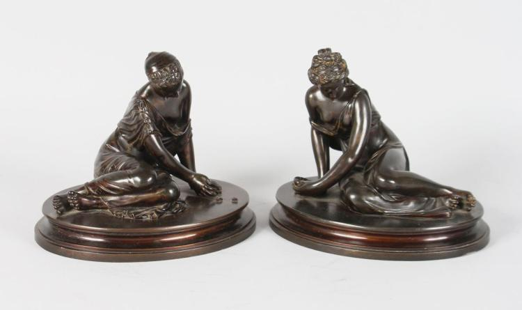 A VERY GOOD PAIR OF BRONZE CLASSICAL YOUNG LADY FIGURES, sitting on oval bases. 6ins high.