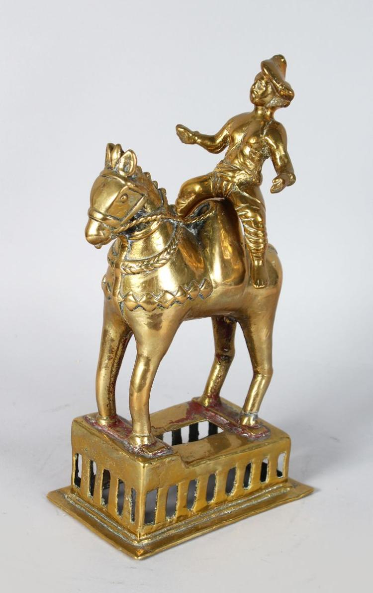AN INDIAN BRONZE OF A HORSE AND RIDER.