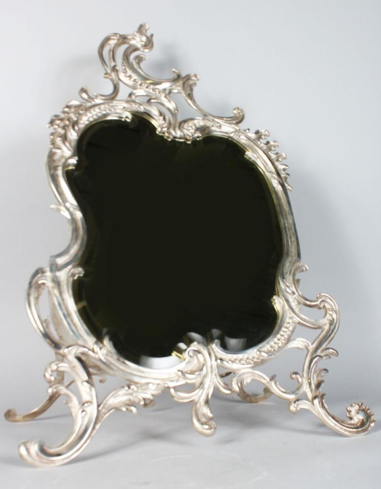 A VERY GOOD SILVERED BRONZE SHAPED EASEL MIRROR with bevelled edge. 25ins high.