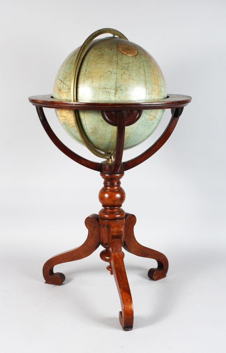 A GOOD 12-INCH 19TH CENTURY GLOBE, by W & AK JOHNSTON geographical engravings and prints to the Queen, on a stand with tripod base.