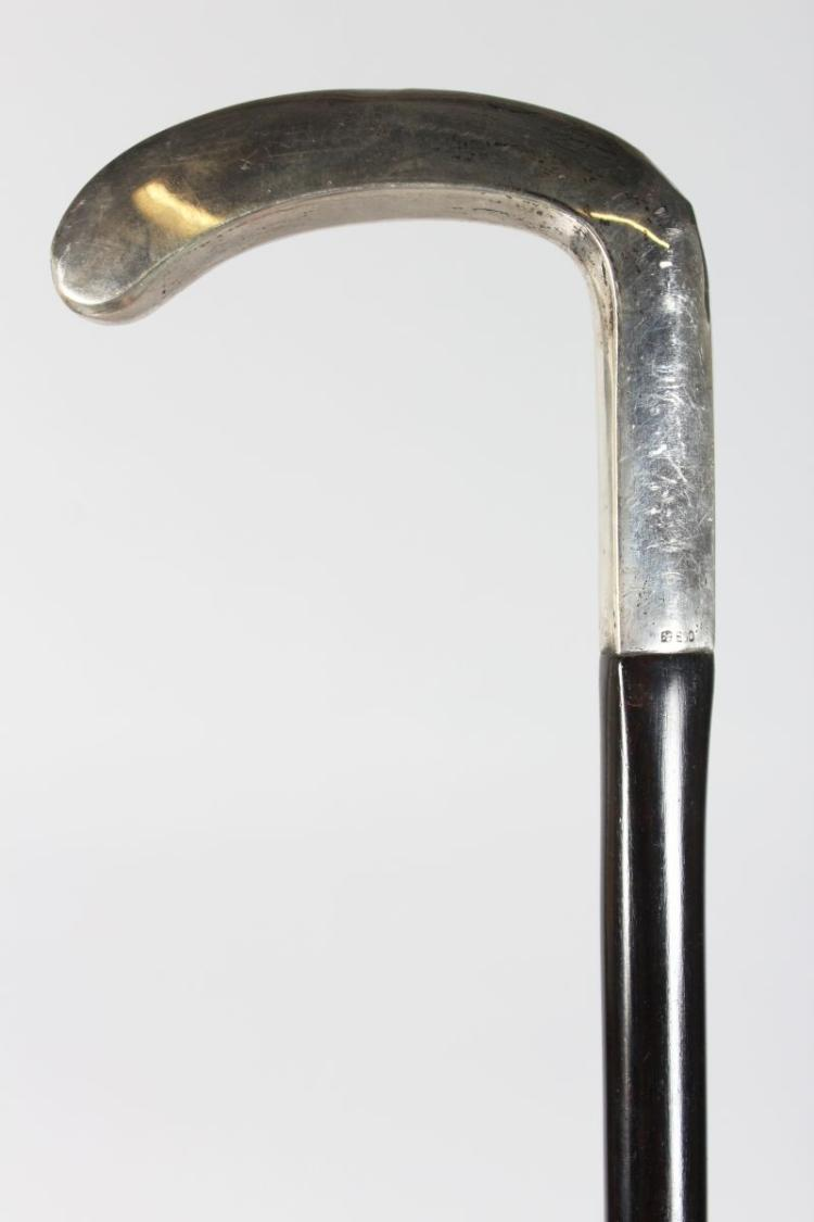 A WALKING STICK, with plain silver handle.