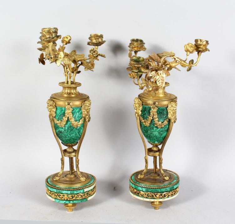 A VERY GOOD PAIR OF LOUIS XVI MARBLE AND ORMOLU URN SHAPED CANDELABRA, with three rose scrolling branches, the marbles arms with masks and garlands on circular marble bases. 15ins high.