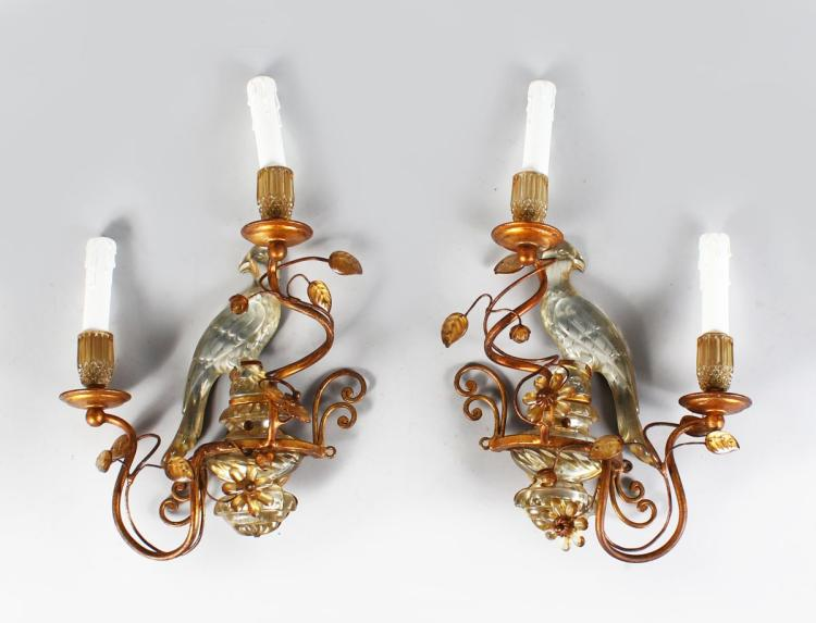 A SUPERB PAIR OF MAISON BAGUES CRYSTAL AND GILT METAL WALL SCONCES, 14.5ins high, excluding candles, a pair of crystal parrot wall sconces, with parrots and flower heads, with two gilt scrolling branches and two candle holders. 16ins high x 12ins wide.