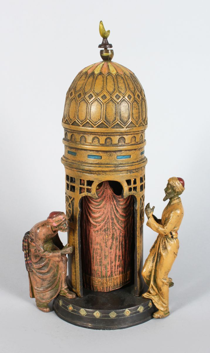 AN AUSTRIAN COLD PAINTED TEMPLE, with two Arabs, sliding door to reveal a female nude. 12ins high.