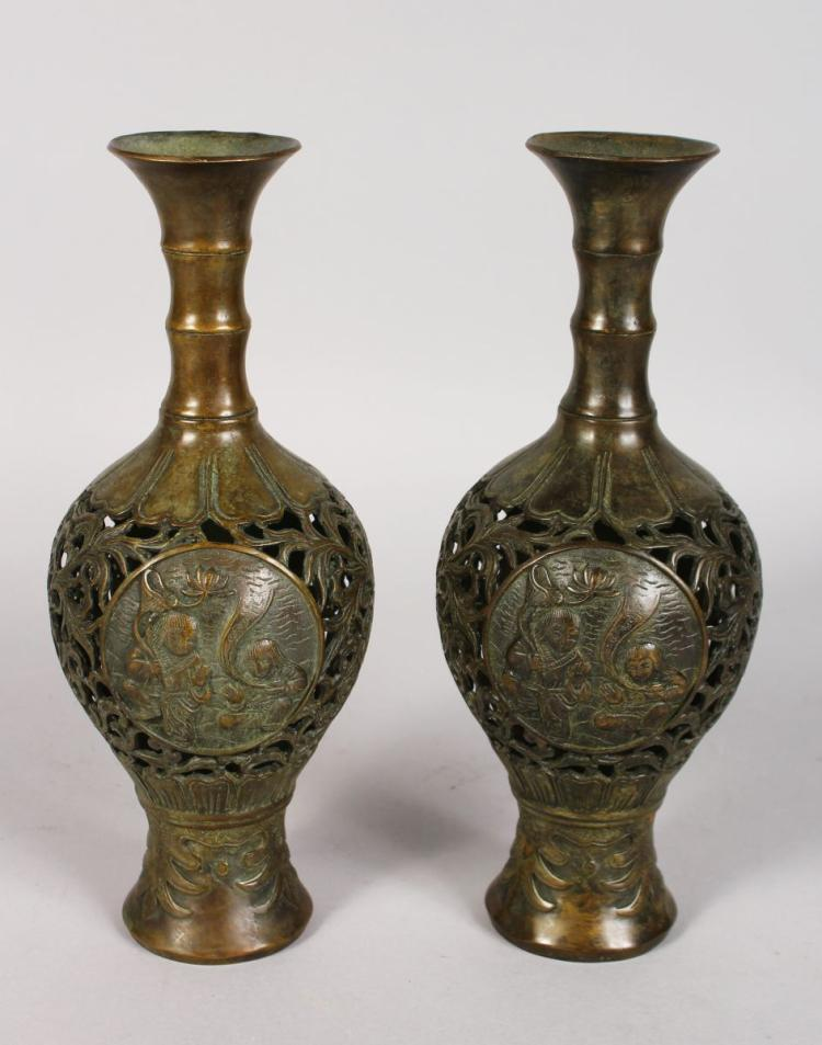A PAIR OF JAPANESE PIERCED BRONZE VASES. 10ins high.