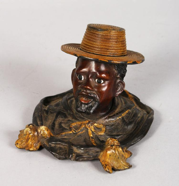 A COLD PAINTED BRONZE NEGRO ASHTRAY. 3.5ins high.