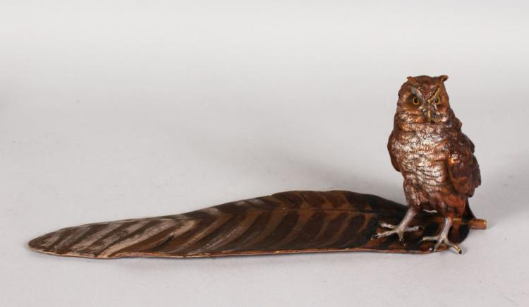 A COLD CAST INKWELL AS AN OWL STANDING ON A FEATHER. 12ins long.