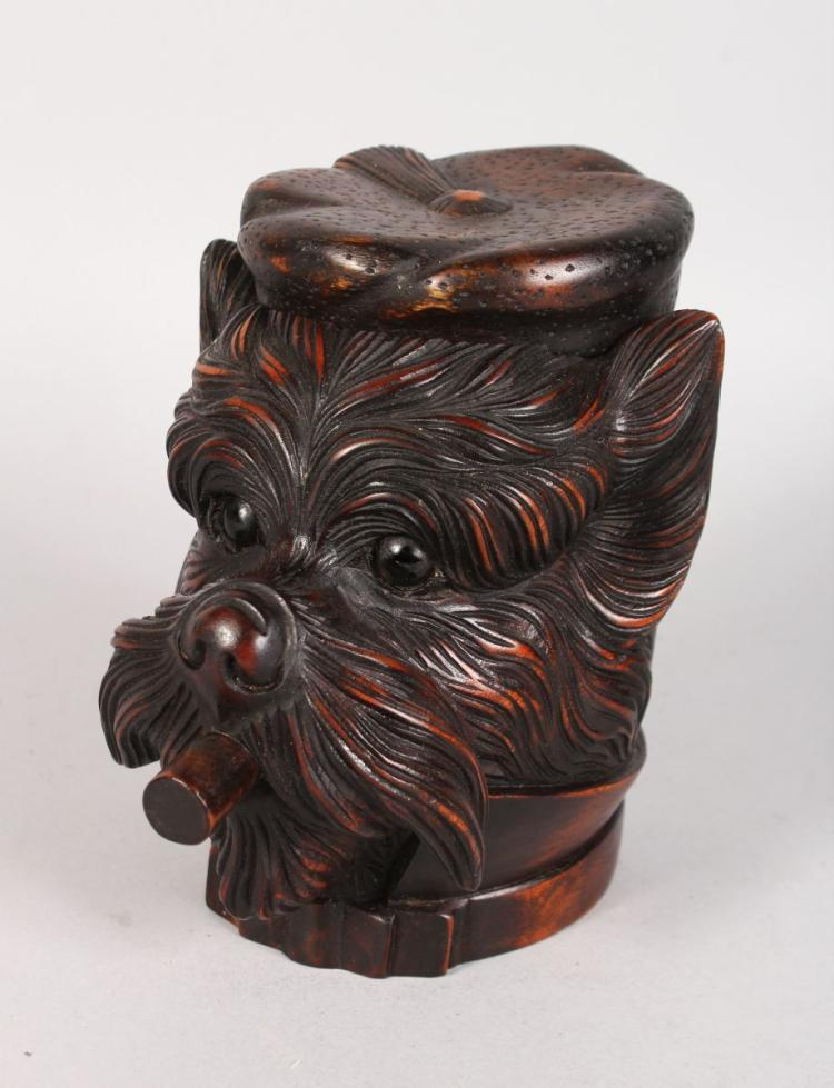 A BLACK FOREST CARVED WOOD DOG'S HEAD with hinged top and smoking a cigar. 7ins high.