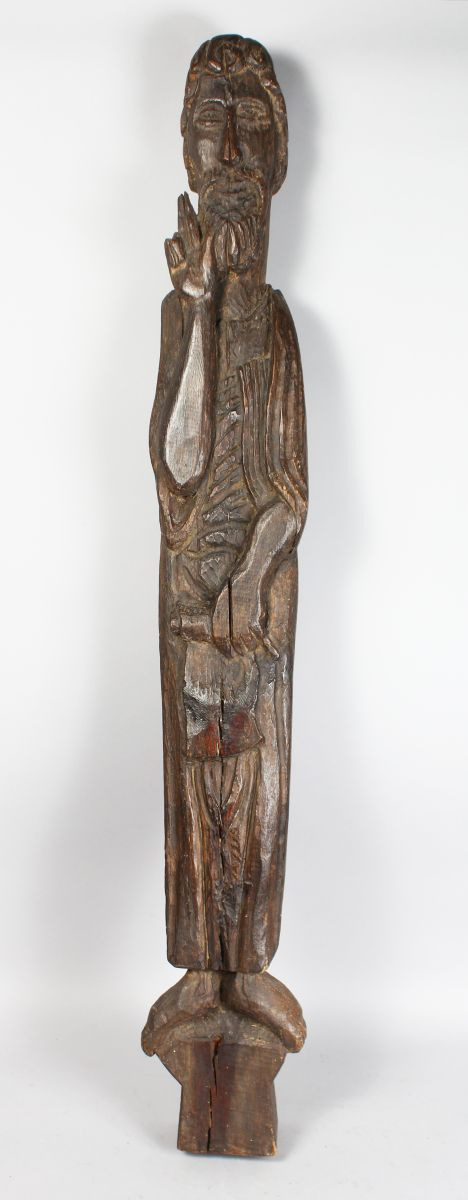 A LARGE EARLY CARVED WOOD SLENDER FIGURE OF A SAINT. 44ins high.