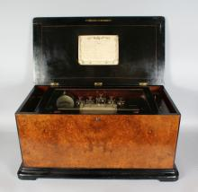 A SUPERB LARGE 19th CENTURY WALNUT CASED MUSICAL BOX with orchestral movement playing eight airs with drum and bells. <br>FABRIQUE DE GENEVA No. 3072. <br>Case 2ft  5ins long, 1ft 4ins deep, 1ft 2ins high.