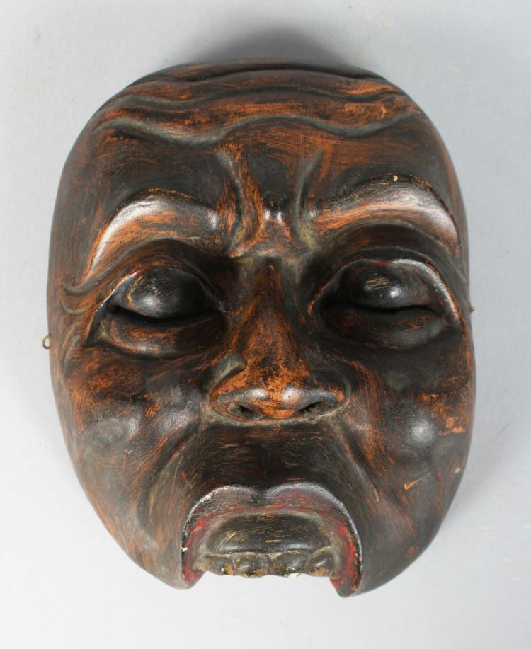 A POLYCHROME CARVED WOODEN DANCE MASK (TOPENG) of Kebo Sepati Bali or Lombok, Indonesia, finely carved with fine patina. 19th century.