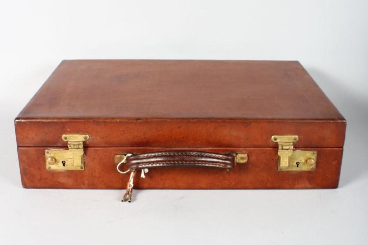 A TOP QUALITY LEATHER BRIEF CASE.