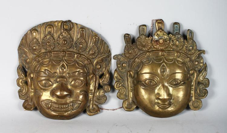 A PAIR OF INDIAN MASKS.