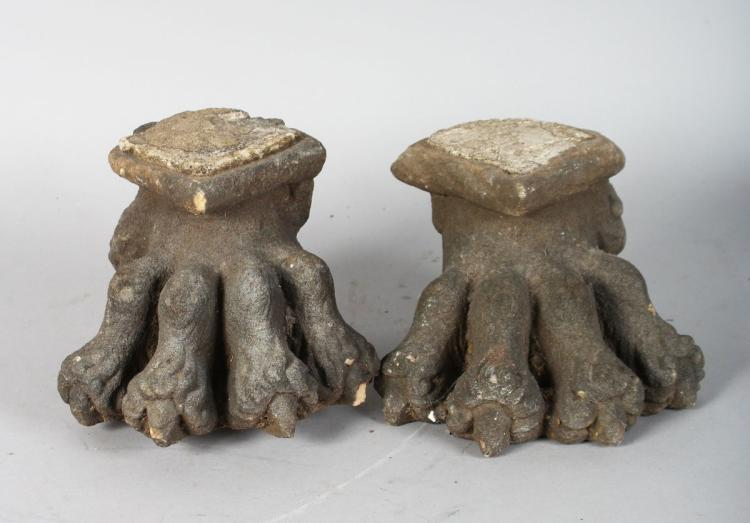 A PAIR OF EARLY STONE LION PAW FEET. 6ins long.