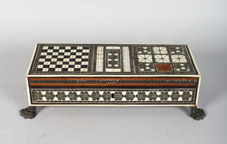 A GOOD ISLAMIC INLAID TRAVELLING CHESS BOX AND PIECES, on claw feet. 11ins wide.