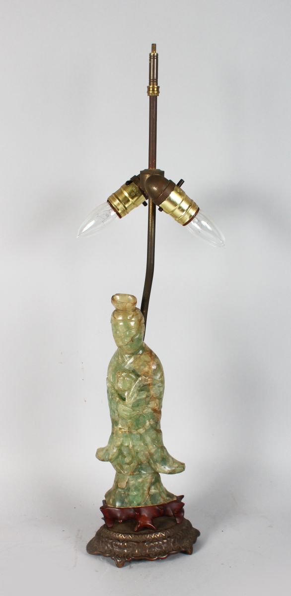 A CHINESE CARVED GREEN QUARTZ FIGURE OF GUANYIN as a lamp.