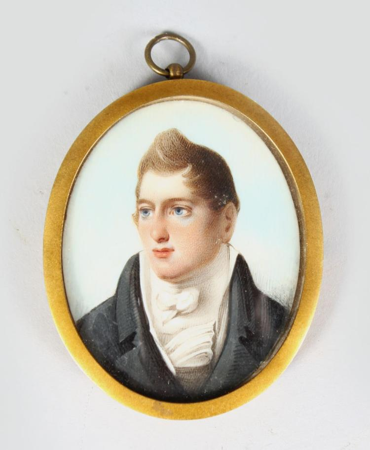 A SMALL OVAL MINIATURE OF A GENTLEMAN wearing white cravat and black coat. 2ins x 1.75ins, framed and glazed.
