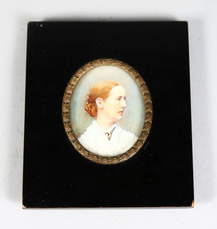 AN OVAL MINIATURE OF A LADY in white dress 2.5ins x 2ins, framed and glazed 4.5ins x 4ins.