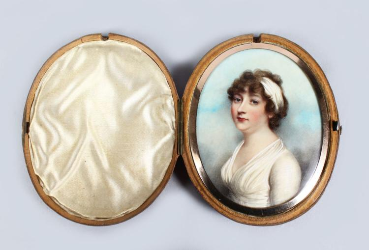 ANDREW PLIMER (1763 - 1837) A FINE OVAL PORTRAIT OF LADY GRAHAM, wearing a white headband and white dress in and oval gold frame, the reverse with plaited hair. 7.5cm x 6cm, in a folding leather travelling case.