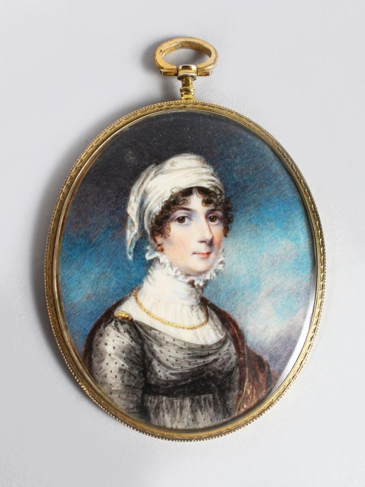 A GOOD OVAL PORTRAIT OF A LADY, wearing a white head scarf, large lace collar, a gold chain and black lace dress, signed on the sleeve, the signature ending with a capital N, in an oval gilt mount. 7.5cm x 5cm.