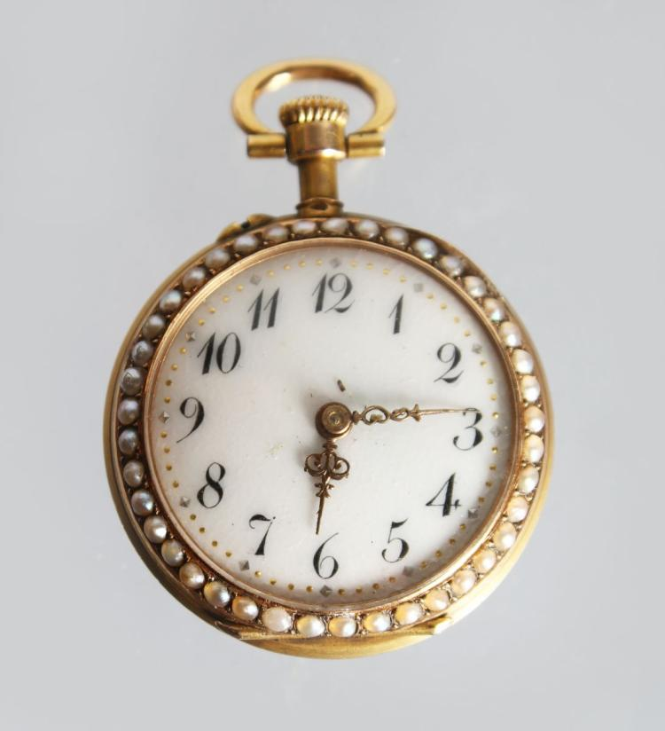 A GOOD GOLD AND ENAMEL FOB WATCH, with enamel dial, Arabic numerals, the bezels inlaid with seed pearls, the back with enamel and gem set decoration. 1ins diameter.
