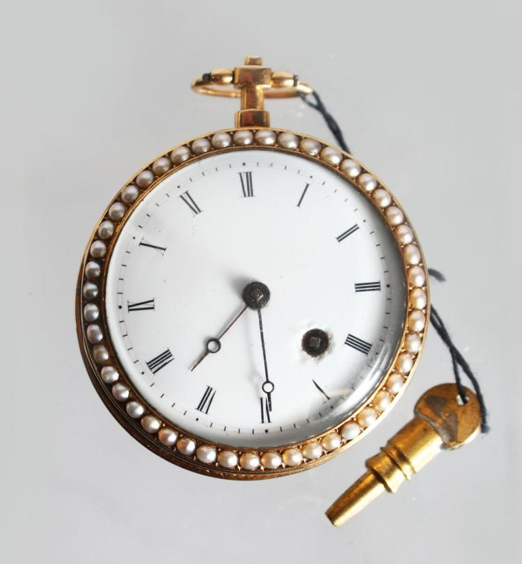 A GOLD AND ENAMEL FOB WATCH, with white enamel dial, Roman numerals, the bezels set with seed pearls, the back engine turned and green enamel decorated. 1.5ins diameter.