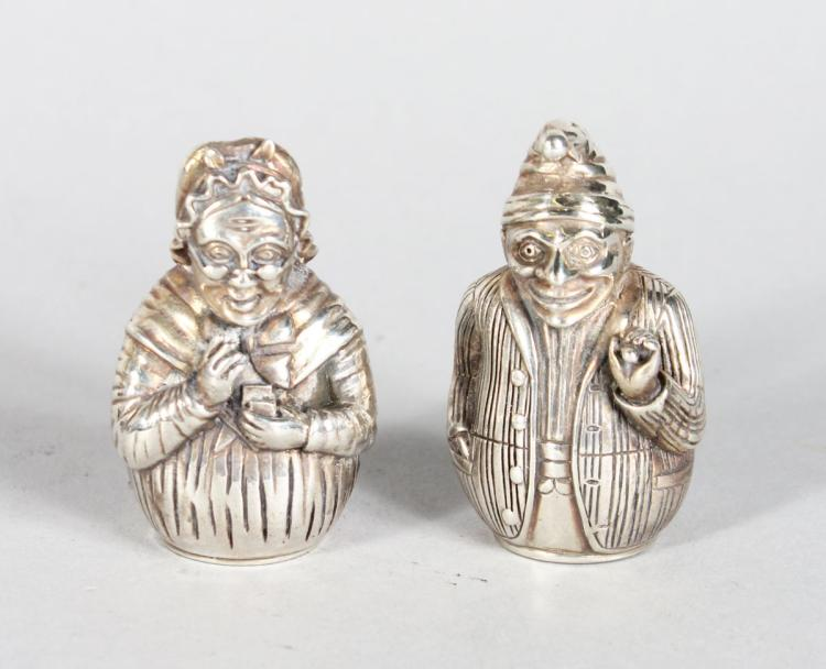 A GOOD PAIR OF SILVER PUNCH AND JUDY SALT AND PEPPERS.